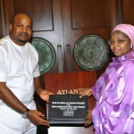 CELD's Mr.Sam Hart handing over certificate of participation to the first lady of Gombe State