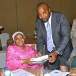 CELD's Mr.Sam Hart handing over the program's gift item- a mini-ipad to the first lady of Gombe State