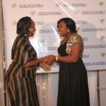 Executive Director of CELD, Mrs Furo Giami congratulating Dr. Jacqueline Kitulu during the African Women of Influence Awards Ceremony