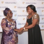 Executive Director of CELD, Mrs Furo Giami congratulating Hon. Mulikat Akande-Adeola during the African Women of Influence Awards Ceremony