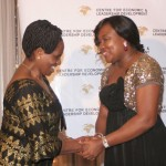 Executive Director of CELD, Mrs Furo Giami congratulating Rt. Hon. Anne Makinda during the African Women of Influence Awards Ceremony