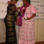 Rt. Hon. Anne Makinda decorating Prof. Comfort Ekpo during the 2012 African Women of Influence Awards